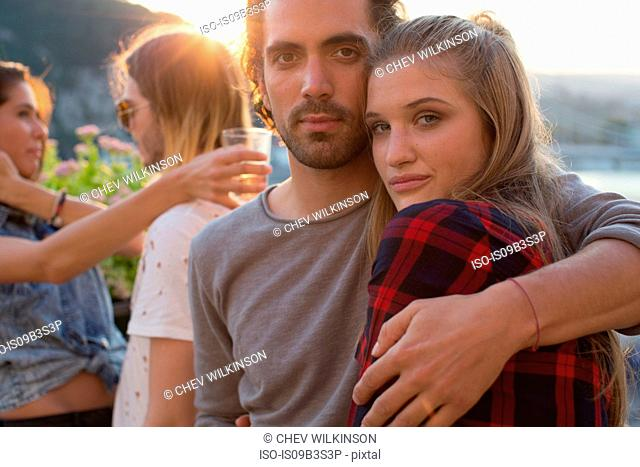 Portrait of couple at waterfront roof terrace party, Budapest, Hungary