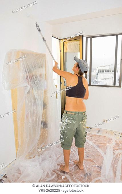 Spanish woman painting her apartment