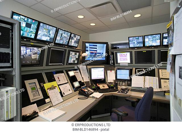 Empty security control room with monitors