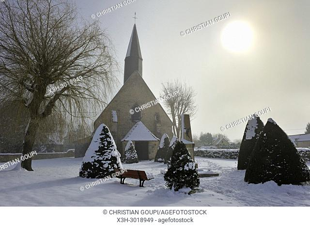 church of the village of Saint-Lucien covered with snow in the mist, department of Eure-et-Loir, Centre-Val-de-Loire region, France, Europe