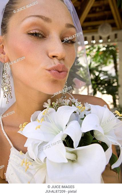 Close up of bride blowing a kiss