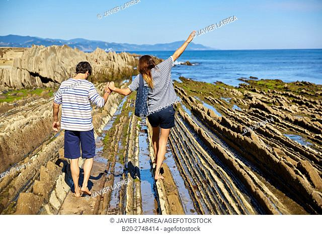 Couple on the beach, Flysch, Algorri, Zumaia, Gipuzkoa, Basque Country, Spain, Europe
