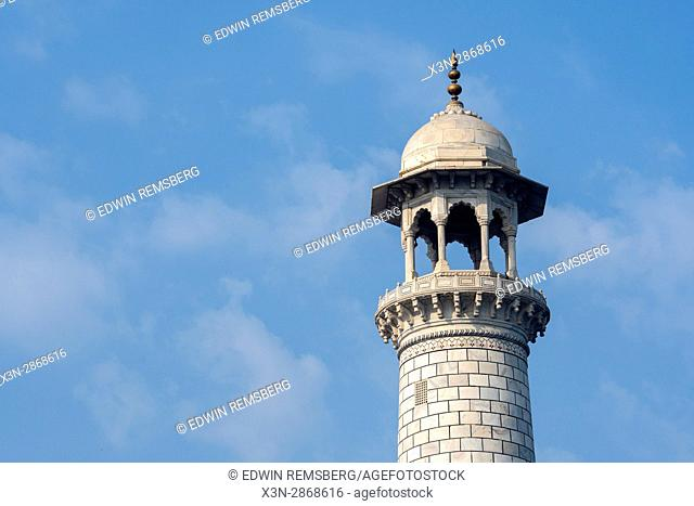 View of one of the four minarets that surround the main tomb of the Taj Mahal, located in Agra, India
