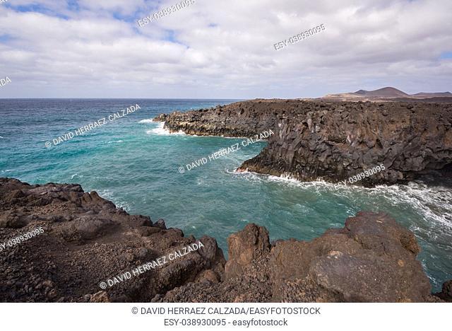Lanzarote landscape. Los Hervideros coastline, lava caves, cliffs and wavy ocean. No people appears in the scene