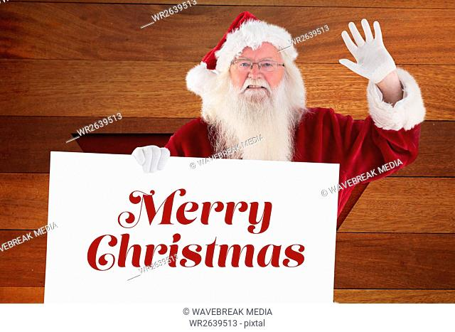 Portrait of santa claus holding christmas greeting