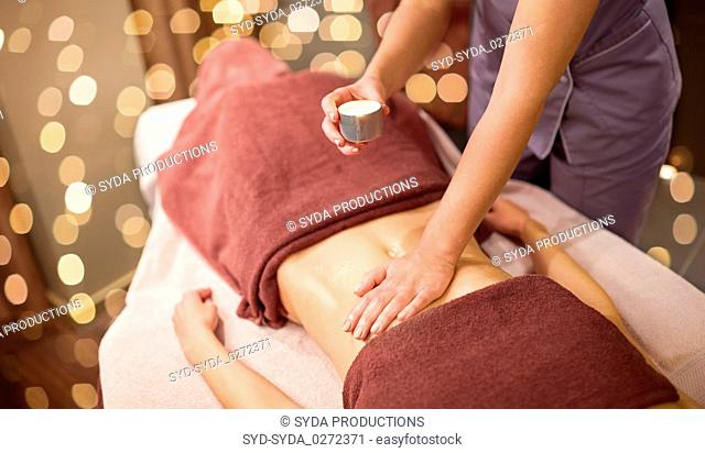 woman lying and having massage with hot oil at spa