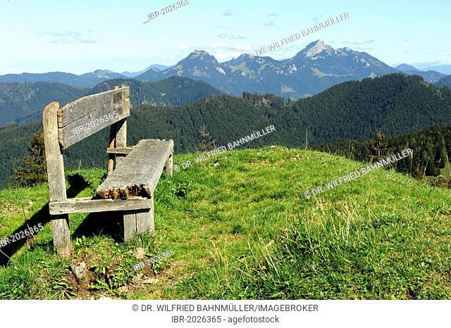 Bench on Kreuzbergalm, mountain pasture, between Tegernsee und Schliersee, Wendelstein mountain range at back, Upper Bavaria, Germany, Europe