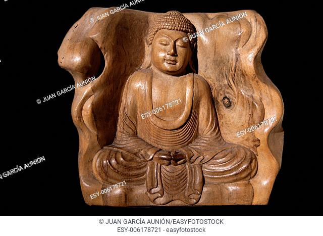 Wooden Figurine Of Meditating Buddha Isolated. Carved