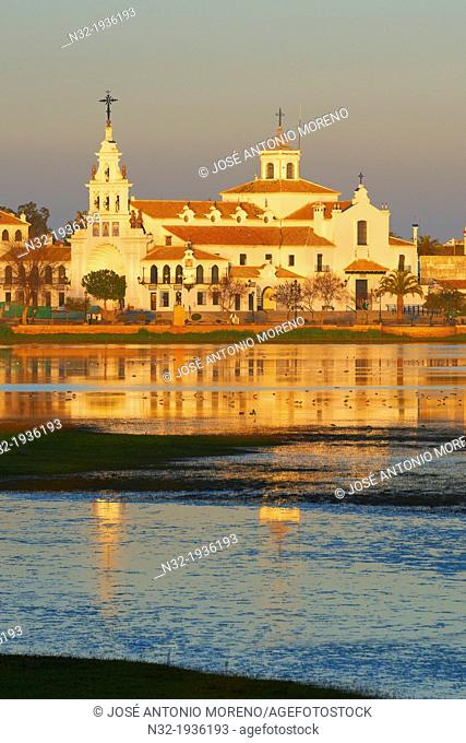 El Rocio village and Hermitage at Sunset, Almonte El Rocio, El Rocio Marismas de Doñana, Doñana National Park, Huelva province, Andalusia Spain