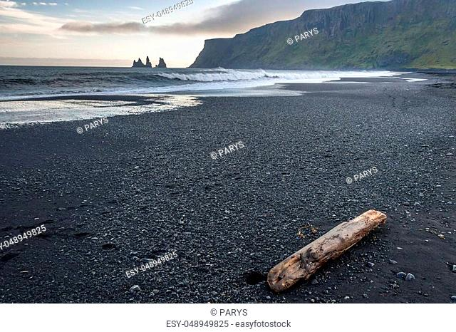 Reynisdrangar rock formations and the mount Reynisfjall. Black beach in Vik, southern Iceland