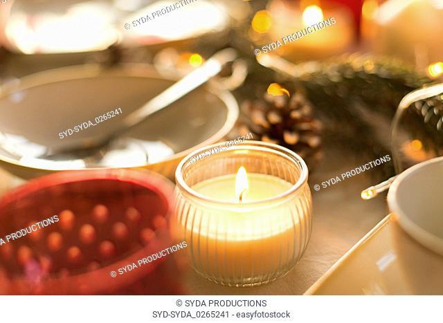 candle burning on christmas table