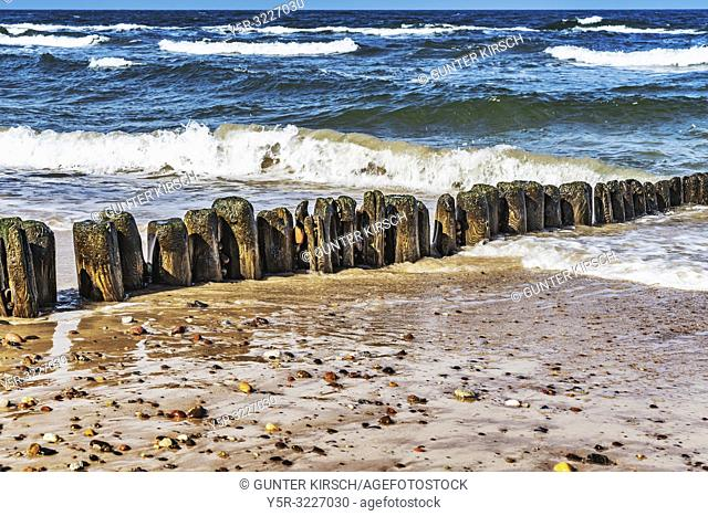 Groynes at the beach of the Baltic Sea near Kolobrzeg. Groynes are intended to break the shaft and to prevent the erosion of the coast