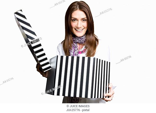 Smiling woman opening large hat box