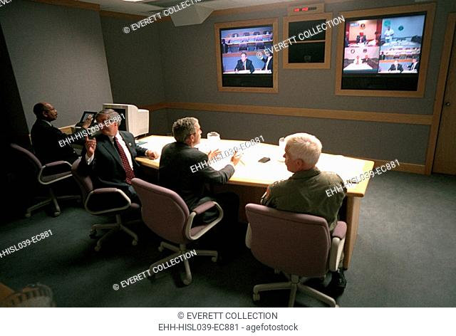 President George W. Bush in a multiscreen video conference at Offutt Air Force Base, Sept. 11, 2001. He met with the National Security Council in a...