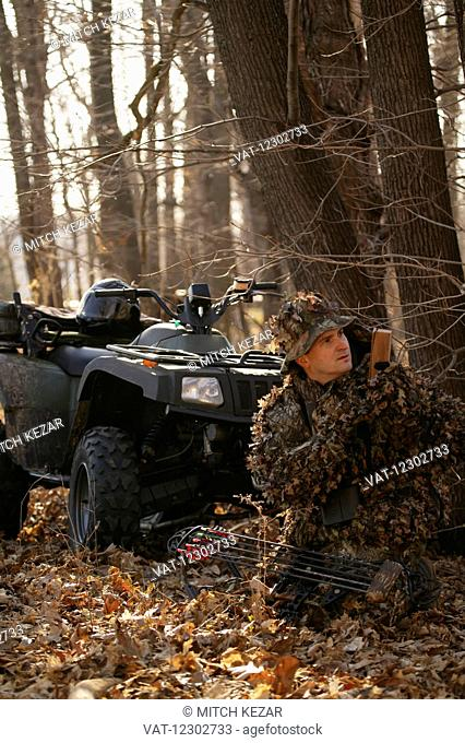 Bowhunter Hunting Turkey In Spring On An ATV