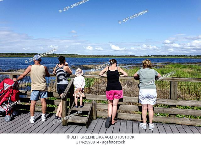 Florida, Sarasota, Myakka River State Park, nature, natural scenery, Lake Myakka, trail, path, raised boardwalk, family, looking, girl, mother, grandmother