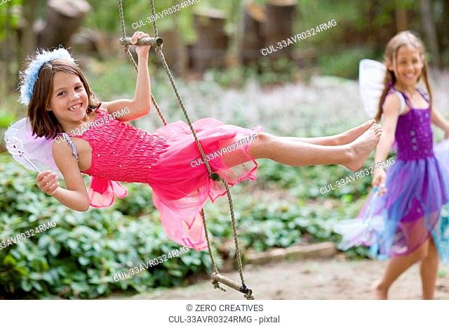 Girl climbing rope ladder in costume