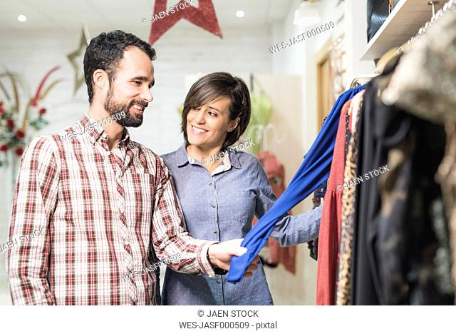 Couple shopping in fashion store