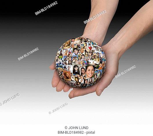 Hands holding ball of collage of smiling face
