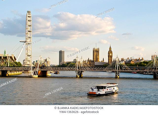 London skyline with Hungerford Bridge, London Eye and Houses of Parliament, London, UK