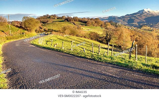 Road (BI-1) between Binenes and Siero, and Sierra de Peñamayor in background. Asturias, Spain