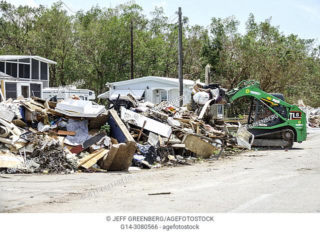 Florida, Everglades City, after Hurricane Irma, houses homes residences, storm disaster recovery cleanup, flood surge damage destruction aftermath, trash
