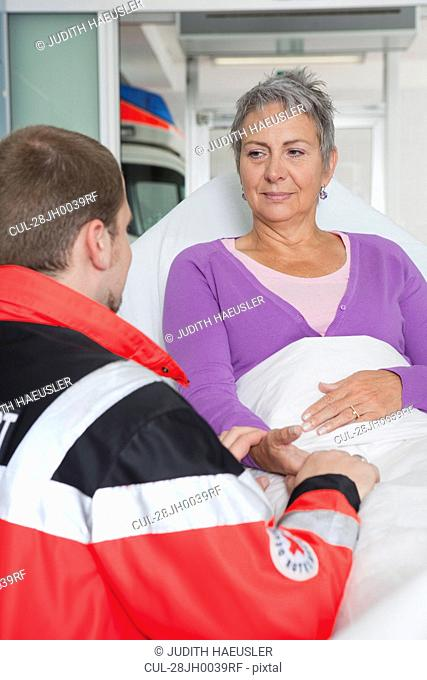 Paramedic caring about woman