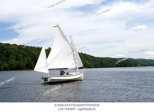 Cat Boat under sail on the CT river in Turners Falls, MA, USA