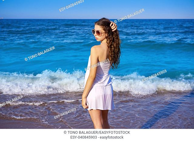 Girl in beach sea shore with summer white dress