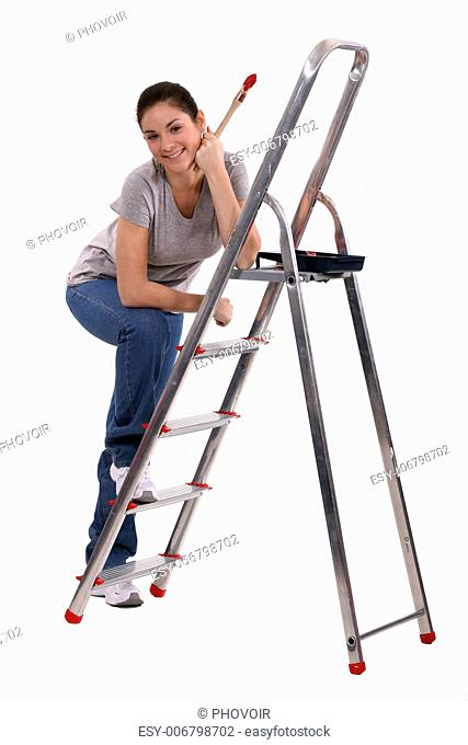 Woman with steps and a paintbrush