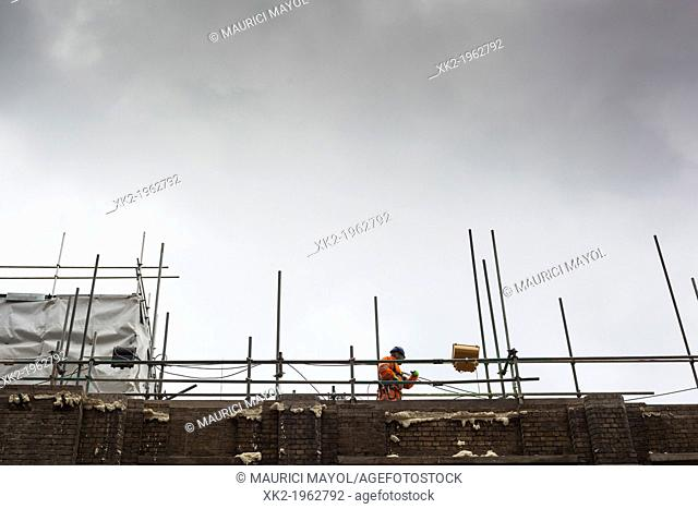 Builder and scaffoldings near London Bridge, London, UK