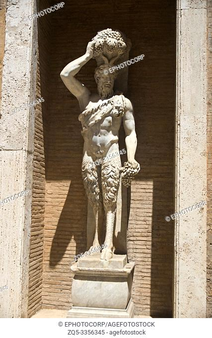 A statue of a roman male holding a bunch of grapes and grape basket over his head, Capitoline Museum, Rome