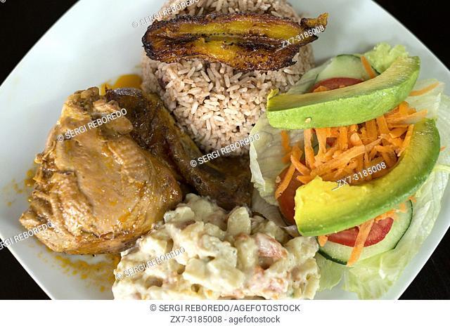 Bennyâ. . s Kitchen local restaurant at San Jose Succotz, San Ignacio, Cayo, west Belize, Central America. Rice, beans, chicken stew and potato salad