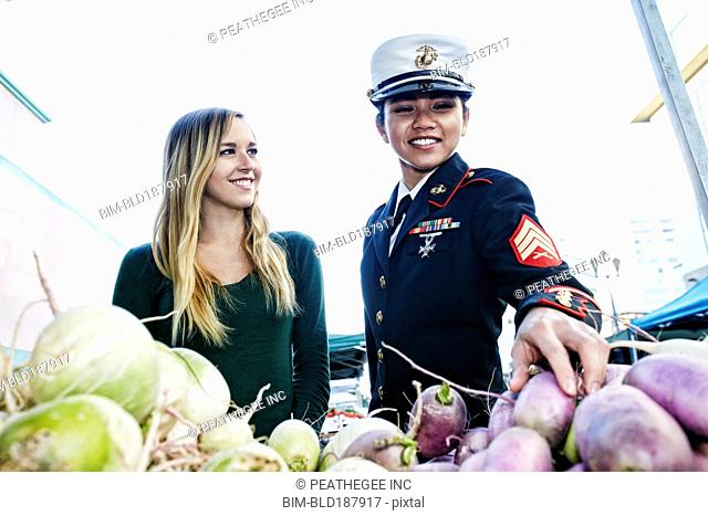 Soldier and friend shopping in farmers market