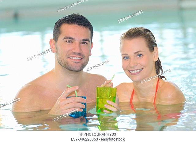 the couple relaxing in the pool during honey moon period