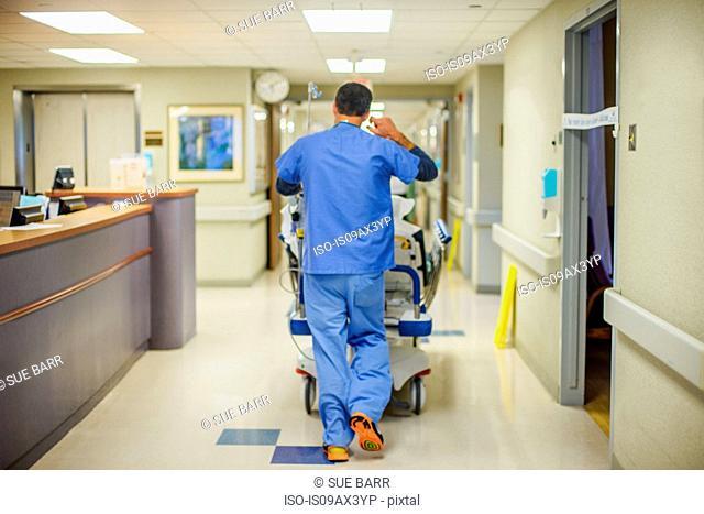 Hospital staff walking away down corridor