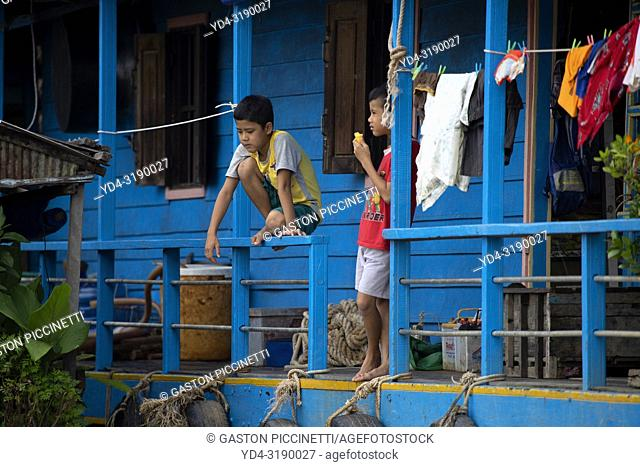 Child in the Houseboat, Chang Kneas floating village, Siem Reap Province, Cambodia. Chang Kneas, is one of the more than 170 villages surrounding the Tonle Sap...