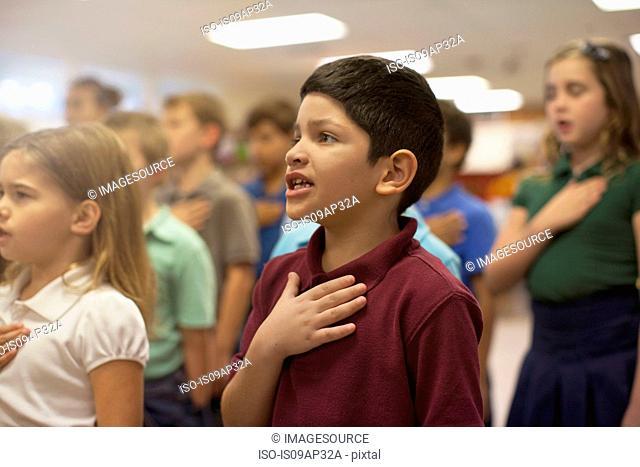 Children reciting Pledge of Allegiance in school