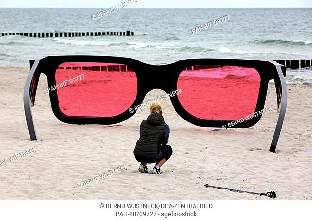 Oversized red glasses titled 'Sea Pink II' by Marc Moser can be seen at the Baltic Sea beach in Zingst, Germany, 26 May 2016