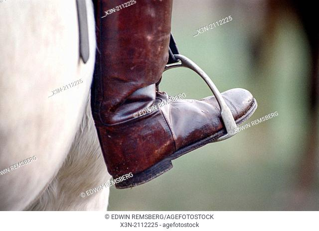 Equestrian boots on stirrups
