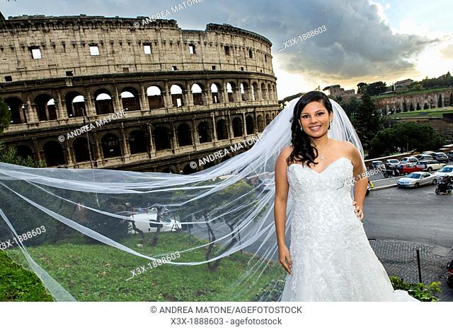 Bride in front of the roman Colosseum in Rome Italy