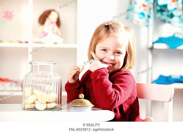 Girl is eating cookies