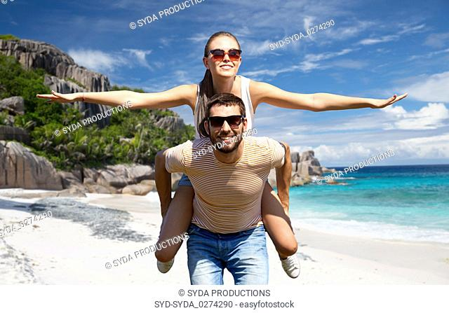 happy couple having fun on seychelles island