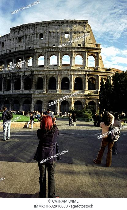 Tourists taking picture of the Colosseum , Rome, Italy, Europe