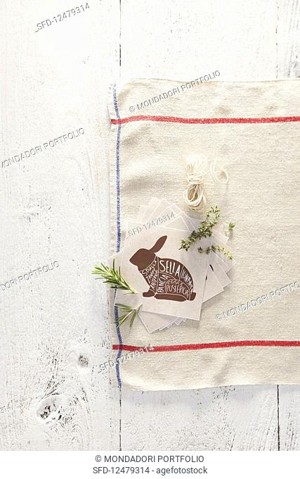 A picture of a rabbit with Italian labels on a tea towel