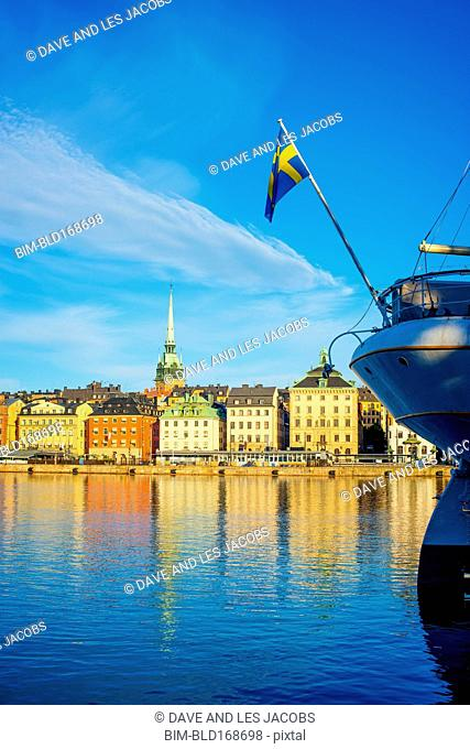 Buildings and boat in harbor in Stockholm cityscape, Stockholm, Sweden