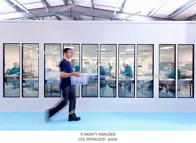 View of workers in clean room in surgical instrument factory