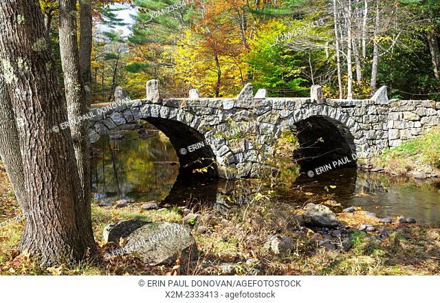 A stone double arch bridge which spans Beard Brook at the meeting of Beard and Jones Road in Hillsborough, New Hampshire USA during the autumn months