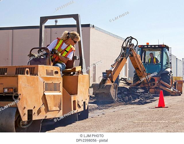 Pothole work crew repairing parking lot; Edmonton, Alberta, Canada