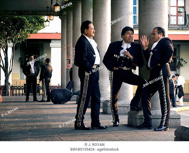Mariachis killing idle time waiting for a job in Plaza Garibaldi, Mexico DF, Mejico, Mexico